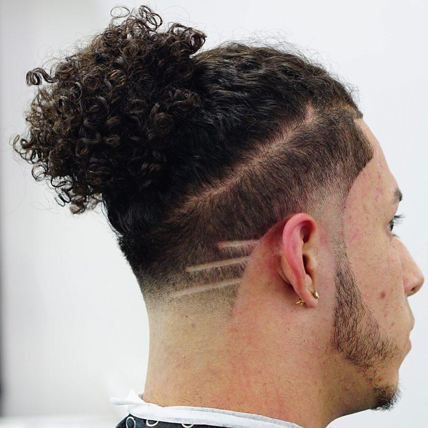 criztofferson curly hair man bun shaved lines mens haircuts