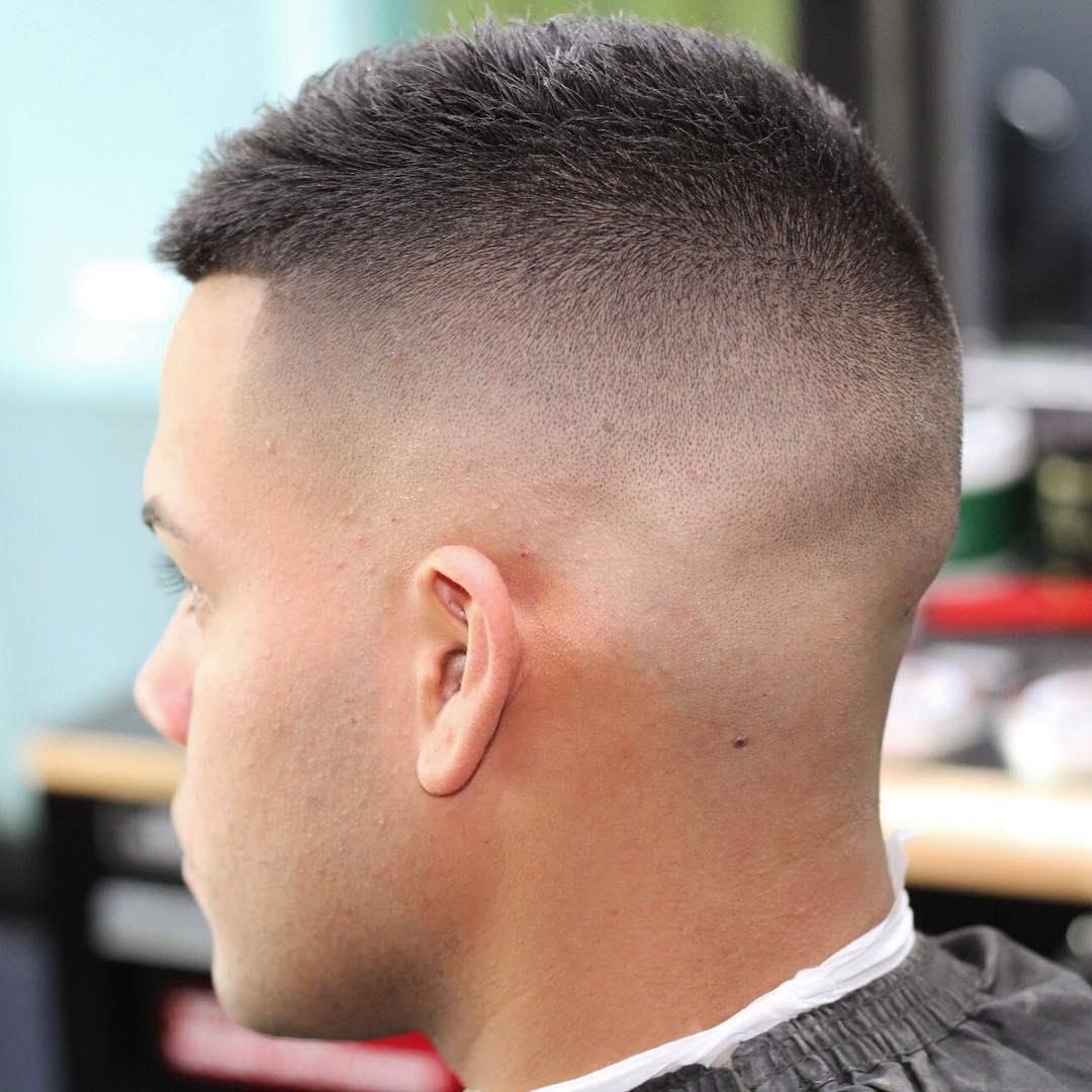 barbernathen short fade haircut with bald fade