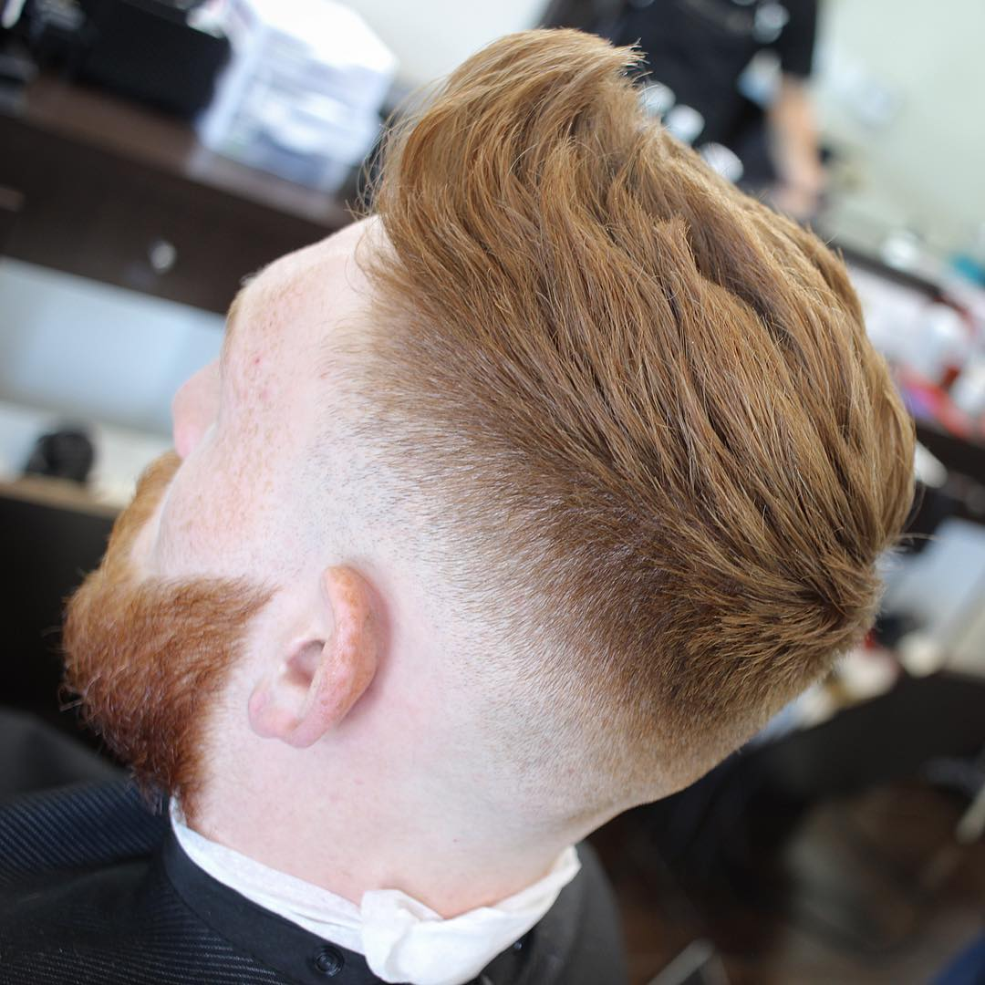 itsclipperovercomb low taper fade haircut red man with beard
