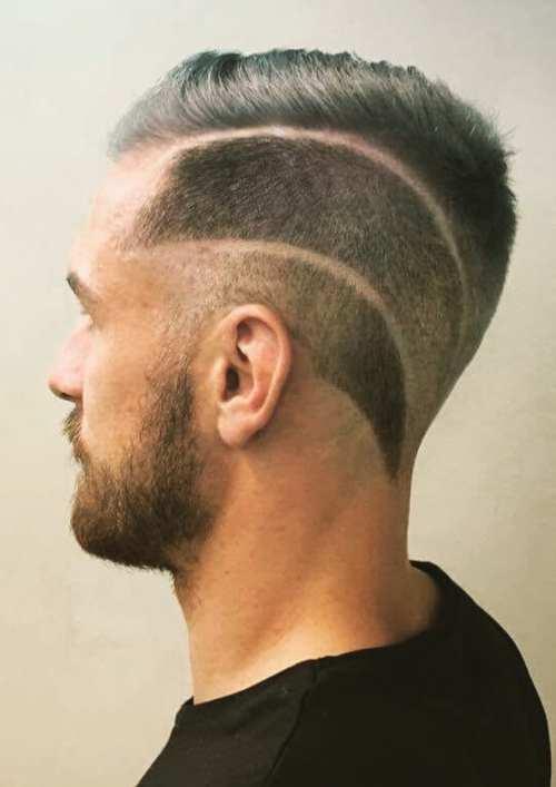 bald fade skin side part with design razor cut