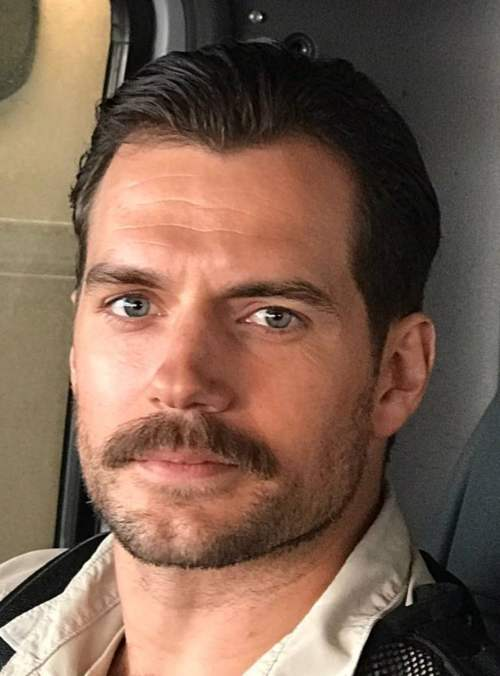 henry cavill mustache slicked back hairstyle