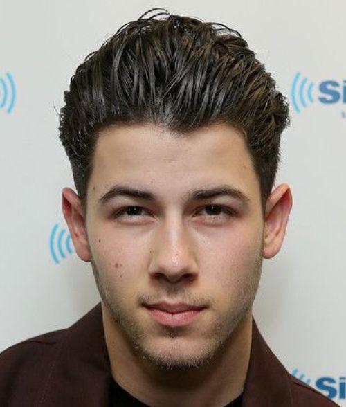 9 nick jonas haircut high textured sweep back hairstyle