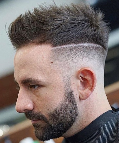 high textured spiky hairstyle with razor line up haircut