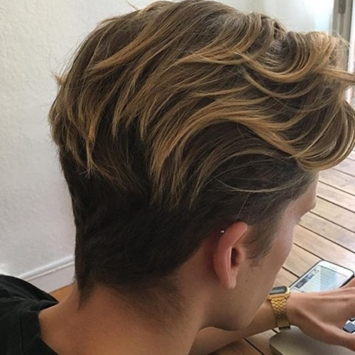 highlighted medium length wavy hairstyle mens