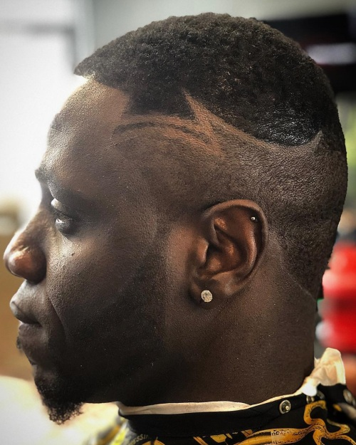 low fade haircut black man with hair design