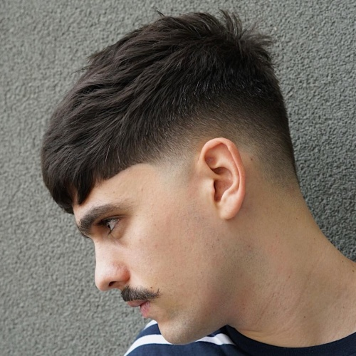 modern mustache with burst fade haircut