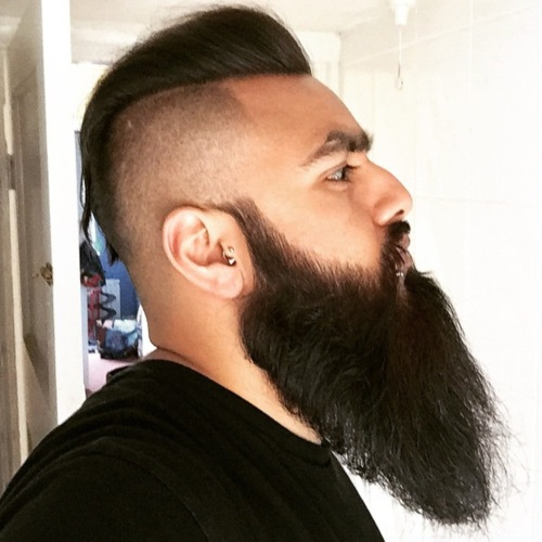 short pompadour slicked back undercut with long men beard style