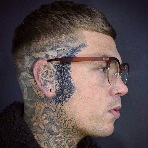 side part low fade skin hairstyle tattoo