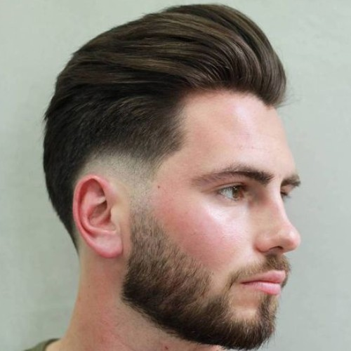 slicked back comb side part burst fade haircut