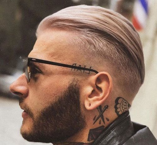 slicked back undercut side part fade men