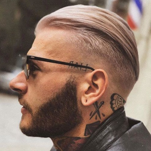 slicked back long undercut side part fade men