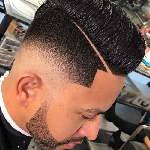 slicked back undercut line up low fade style