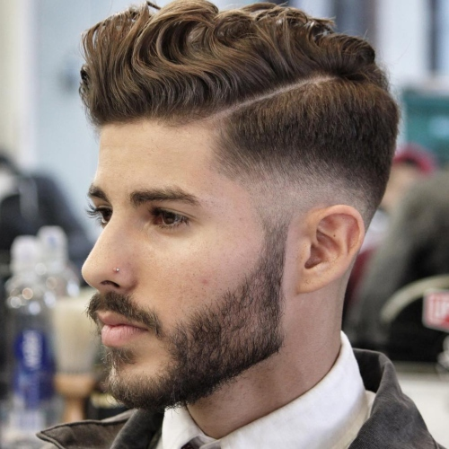 wavy quiff high textured side part fade men's hairstyle